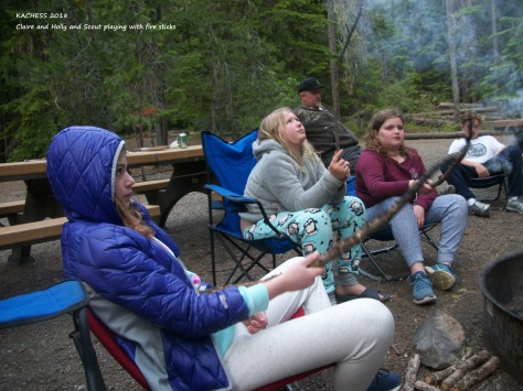KACHESS 2018 Scout friends Holly and Claire around campfire with smoke sticks
